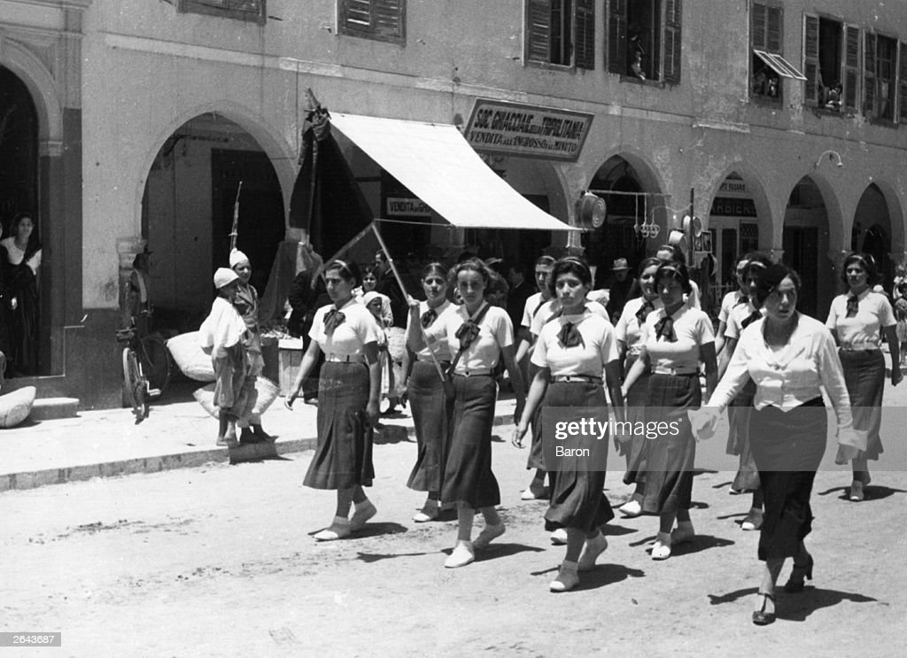 Black shirts are not worn but these girls are members of the Italian Fascist organisation taking part in a parade in Tripoli on review day