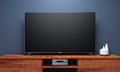 Black Smart Tv Mockup on wooden console. 3d rendering