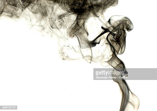 Black Smoke Against White Background