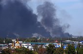 Black smoke ascends around the Donetsk's International Airport as shelling continues between proRussian forces and the Ukrainian army on September 14...