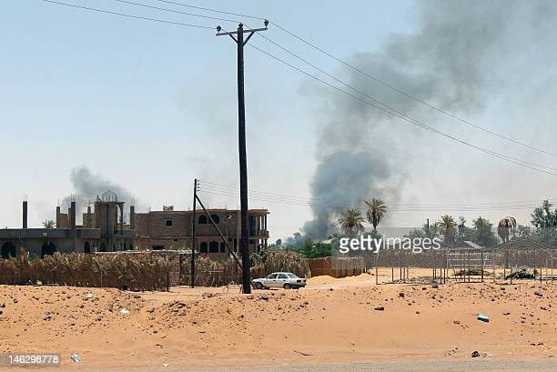 Black smoke billows as fighting takes place in the southern oasis city of Kufra located in a triangle where the borders of Egypt Chad and Sudan meet...
