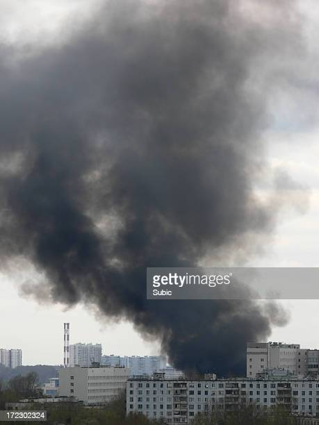 Black smoke coming out of a building on fire