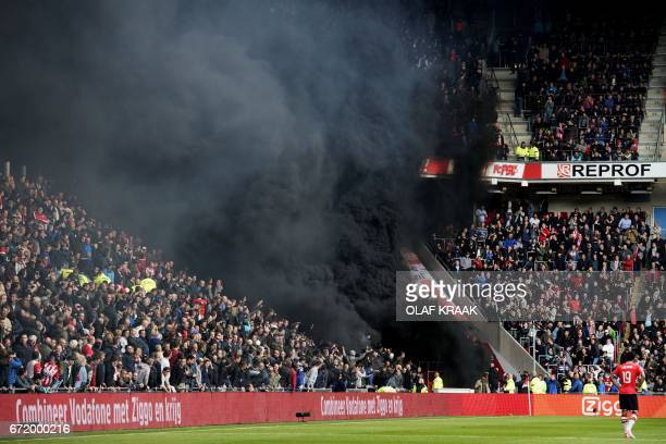 TOPSHOT Black smoke engulfs the tribune during the PSV Eindhoven vs Ajax KNVB Cup football match in Eindhoven on April 23 2017 / AFP PHOTO / ANP /...