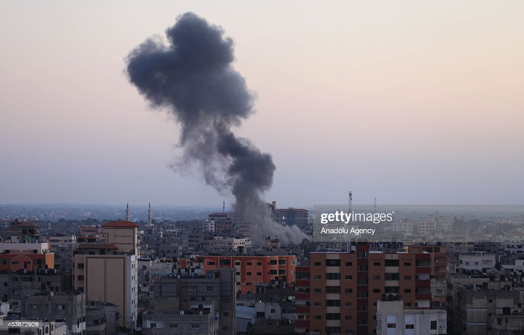 Black smoke rises after an airstrike of Israeli forces upon the claim of launching rockets from Gaza to Israel, in Gaza city, Gaza on 20 August, 2014.