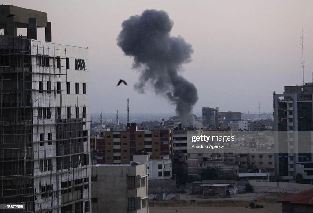 Black smoke rises after Israeli army's attacks on Gaza City upon the claim of launching rockets from Gaza to Israel on August 20, 2014 in Gaza City, Gaza.