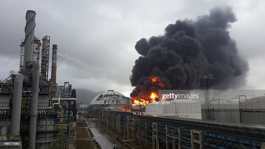 Black smoke rises as a fire rages after an explosion at a plant producing paraxylene a chemical commonly known as PX in Zhangzhou east China's Fujian...
