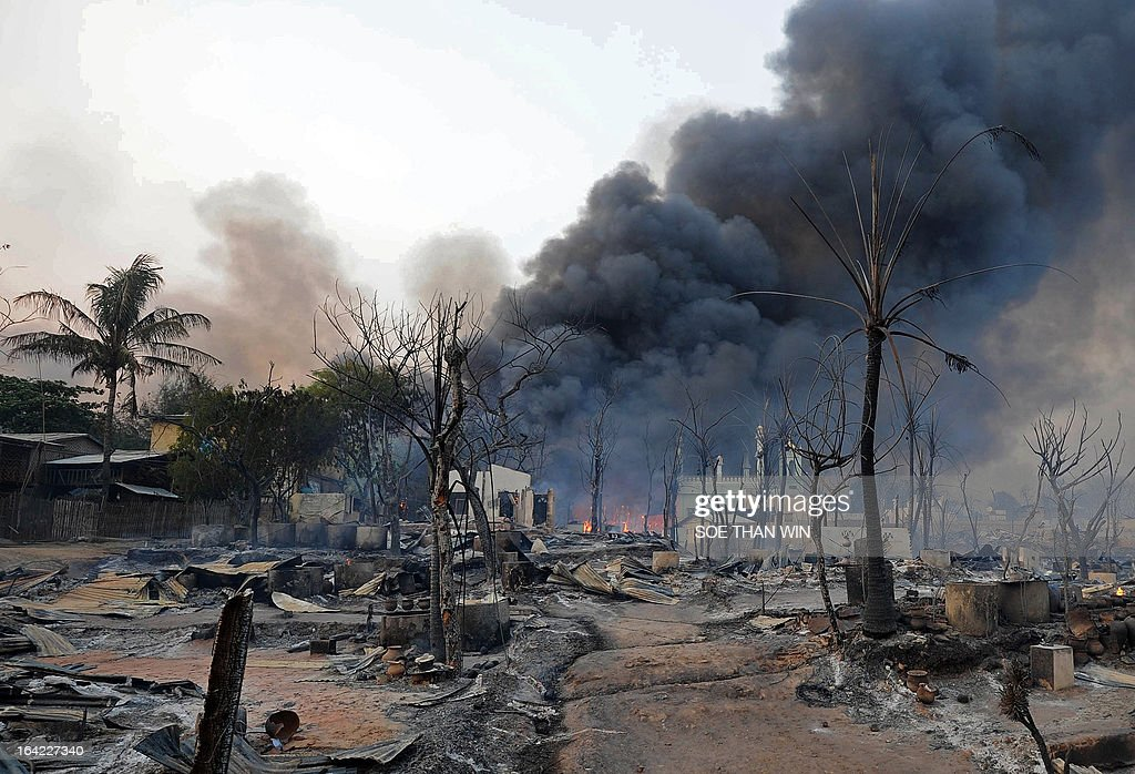 Black smoke rises from burning houses around a mosque in riot-hit Meiktila, central Myanmar on March 21, 2013. At least 10 people have been killed in riots in central Myanmar, an MP said on March 21, prompting international concern at the country's worst communal unrest since a wave of Buddhist-Muslim clashes last year. AFP PHOTO/ Soe Than WIN