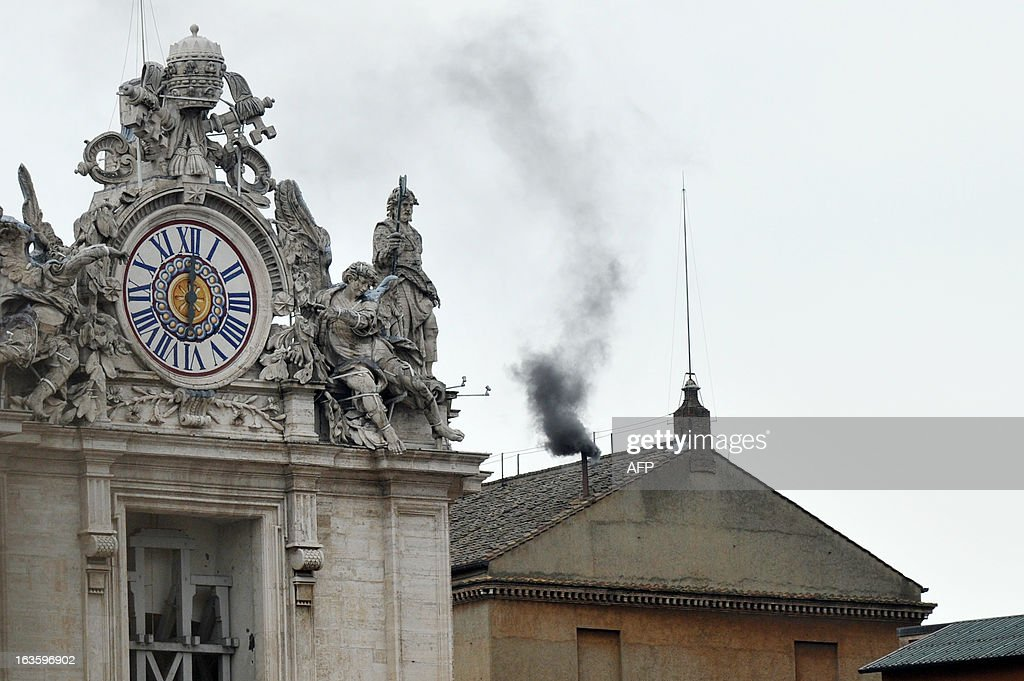 Black smoke rises from the chimney on the roof of the Sistine Chapel meaning that cardinals failed to elect a new pope in the second ballot of their secret conclave on March 13, 2013 at the Vatican. The 115 cardinals vote in the Sistine Chapel in a process of finding a successor to Benedict XVI, who brought a troubled eight-year papacy to an abrupt end by resigning last month. AFP PHOTO / TIZIANA FABI