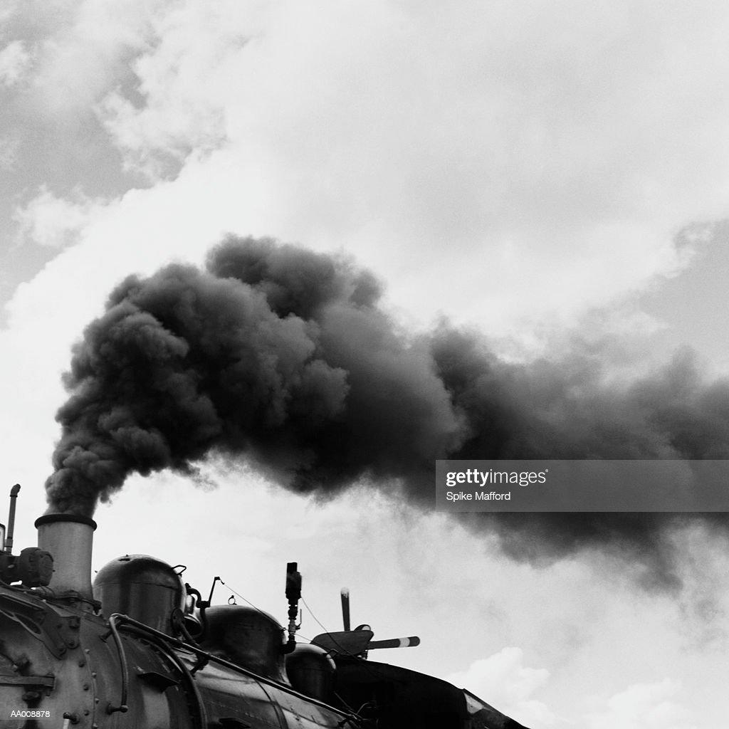 Black Smoke Rising Above a Steam Locomotive : Stock Photo