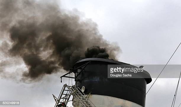 Black smoke rising from a nautical ships exhaust stack