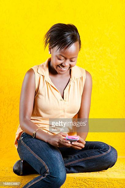 Black South African female texting
