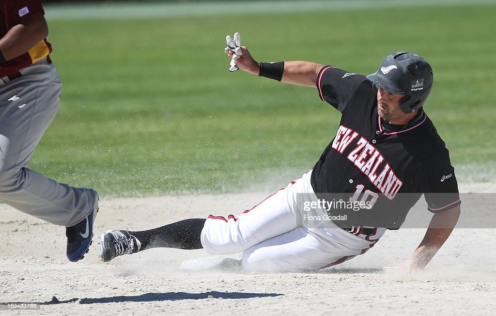 Black Sox captain Rhys Casley slides into second base during the gold medal match between New Zealand and Venezuela at Tradstaff Sports Stadium on March 10, 2013 in Auckland, New Zealand.