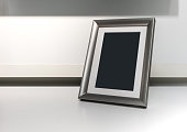 Black space on vertical silver aluminum frame on white desk