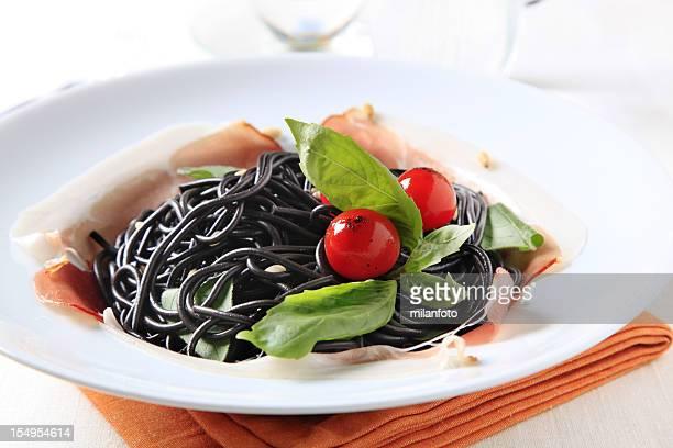 Black spaghetti and prosciutto