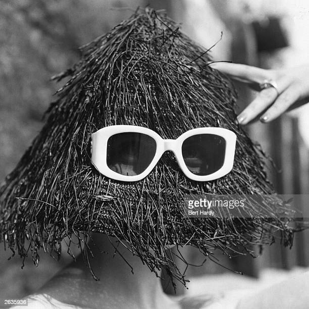 A black spaghetti straw hat with integrated sunglasses a summer beach fashion from Italy Original Publication Picture Post 7235 A Little Nonsense...