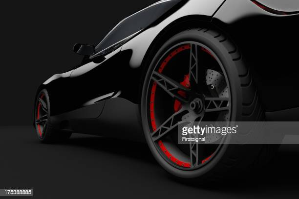 Black sport car on dark background