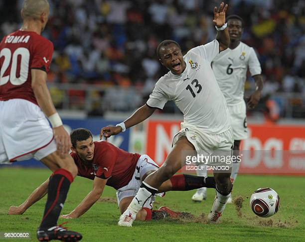 Black star the Ghana National football team player Andre Ayew vies for the ball with Egypt's on January 31 2010 at the November 11 stadium in Luanda...