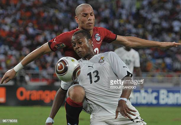 Black star the Ghana National football team player Andre Ayew vies for the ball with Egypt's Gomaa Wael on january 31 2010 at the November 11 stadium...