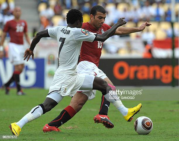 Black star the Ghana National football team player Samuel vies for the ball with Egypt's forward Emad Abdelnaby on January 31 2010 at the November 11...