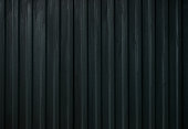 Dark metal mesh. Black steel metallic hole texture background. Dotted metallic iron abstract background