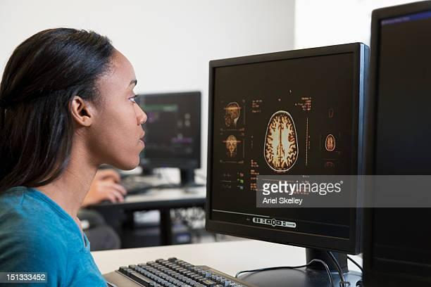 Black student studying science on computers