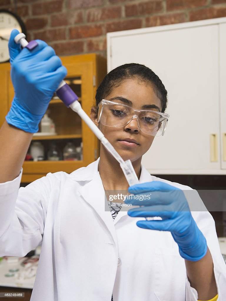 Black student working in science lab : Stock Photo