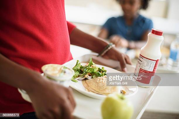Black students eating lunch in school cafeteria