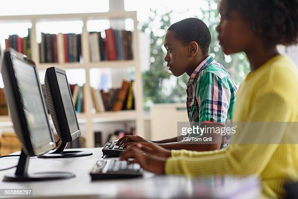Black students using computers in classroom