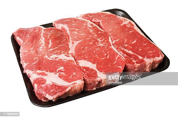 Black Styrofoam Tray of Raw Boneless New York Strip Steaks