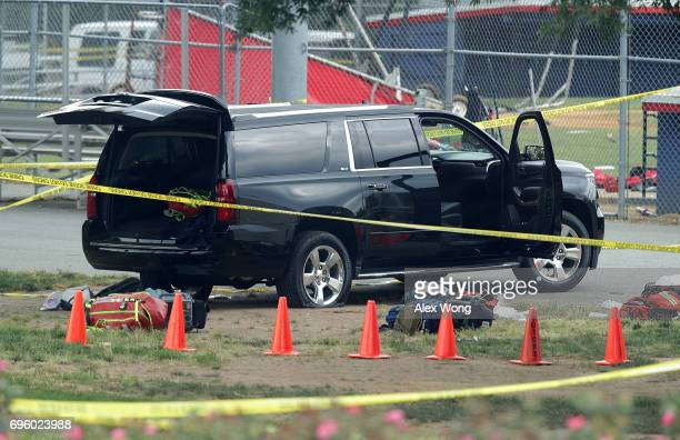 A black SUV with a flat tire and a hole on its windshield is seen outside the Eugene Simpson Stadium Park where a shooting had happened June 14 2017...