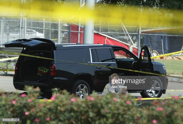 A black SUV with a hole on its windshield is seen outside the Eugene Simpson Stadium Park where a morning shooting occurred June 14 2017 in...