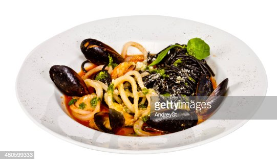 Black tagliatelle (pasta made with cuttlefish ink) with shrumps, : Stock Photo