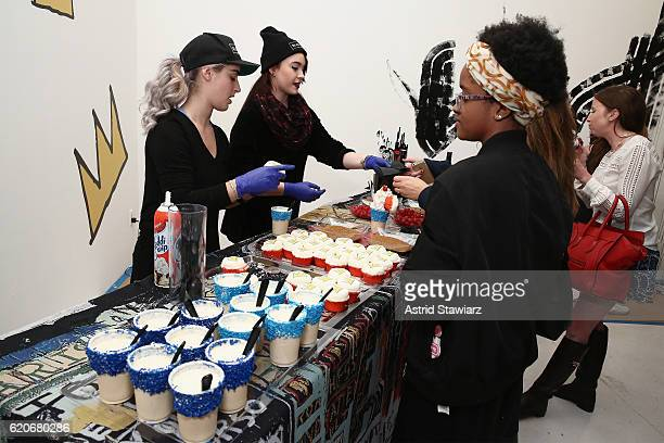 Black Tap cupcakes and shakes on display at the alice olivia x Basquiat CFDA Capsule Collection launch party on November 2 2016 in New York City
