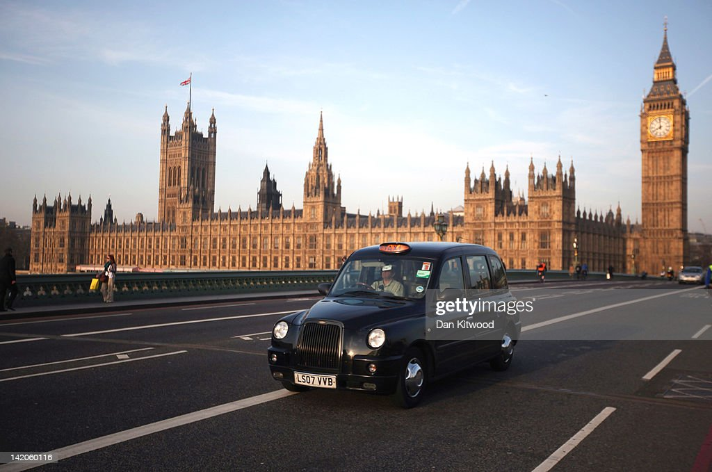 A black taxi cab makes its way over Westminster Bridge on March 28, 2012 in London, England.