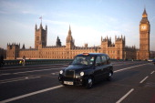 A black taxi cab makes its way over Westminster Bridge on March 28 2012 in London England