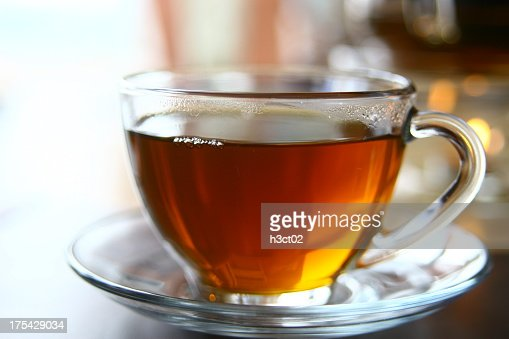 Black tea in a clear cup with saucer