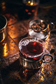 Black tea in a glass cup on dark background