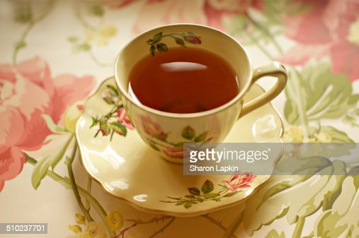 Black tea in vintage teacup and saucer