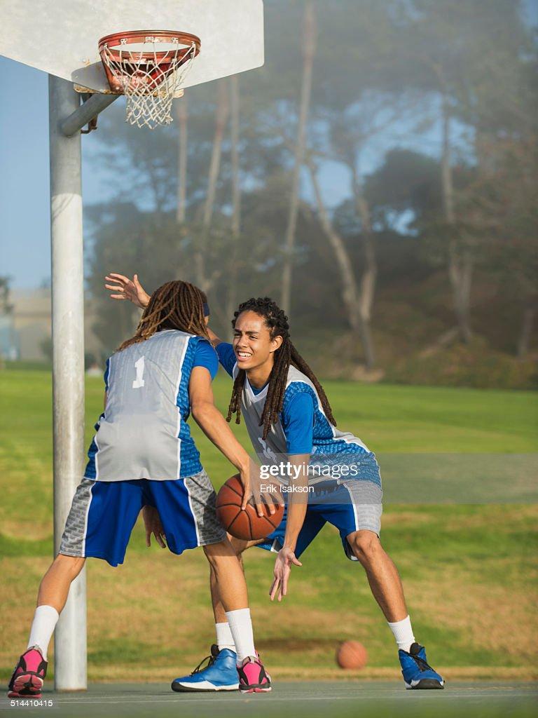 black teenage boys playing basketball on court stock photo getty