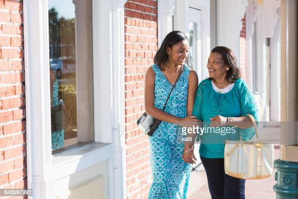 Black teenage girl walking with her grandmother