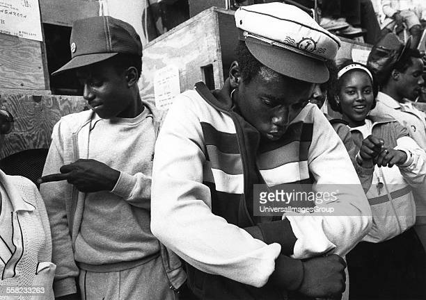 Black Teenagers dancing at a sound system Notting Hill Carvival London UK 1983
