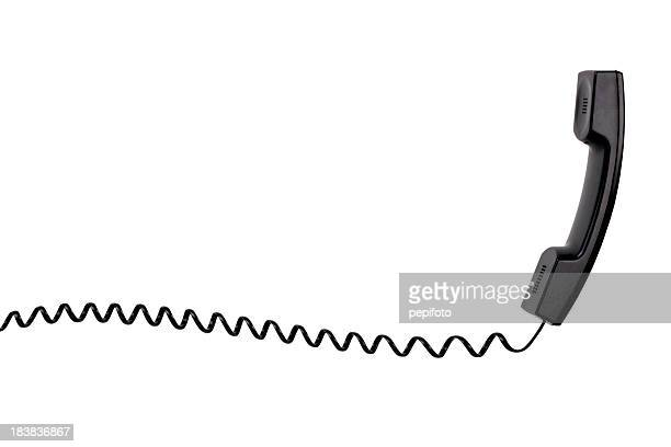 A black telephone with a spiral cord