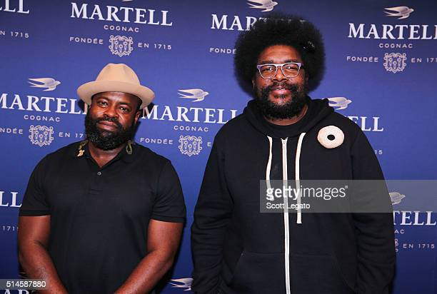 Black Thought and Questlove of The Roots pose during the Martell Vanguard Experience event at Garden Theater on March 9 2016 in Detroit Michigan