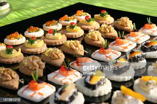 Black tray full of fresh canapes stock photo getty images for Canape serving platters