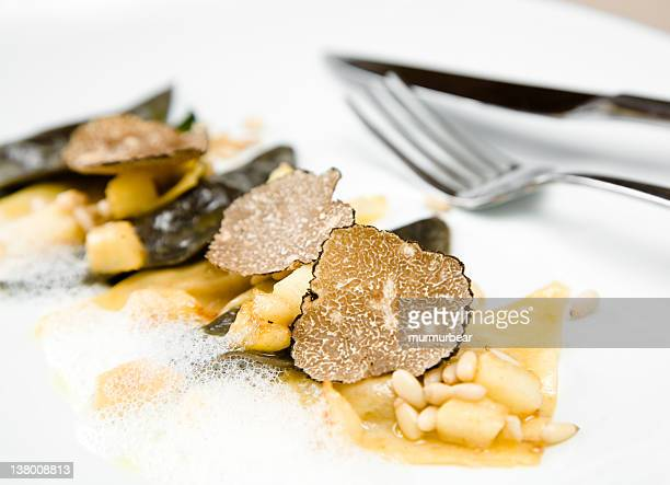 Black truffle ravioli with a fork