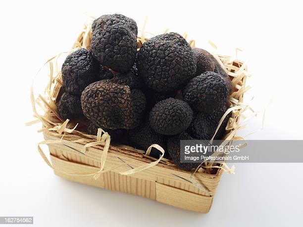 Black truffles in wooden basket