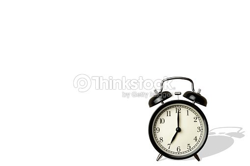 Black Vintage Alarm Clock On White Background With Long Sharp Shadow