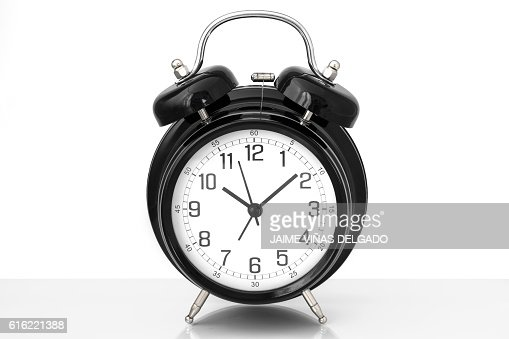 Black vintage alarm clock with white background : Stock Photo