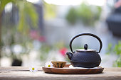 Black vintage teapot and cup with flower