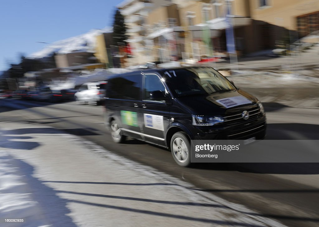 A black Volkswagen van, produced by Volkswagen AG, transports delegates to their hotels following the World Economic Forum (WEF) in Davos, Switzerland, on Saturday, Jan. 26, 2013. World leaders, influential executives, bankers and policy makers attend the 43rd annual meeting of the World Economic Forum in Davos, the five day event runs from Jan. 23-27. Photographer:Simon Dawson/Bloomberg via Getty Images
